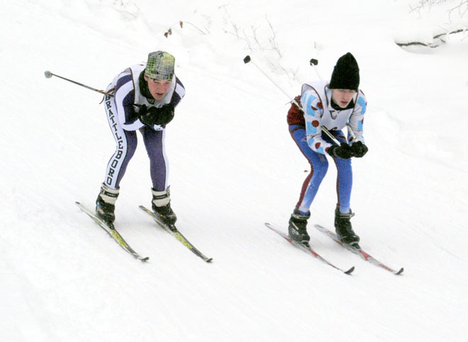 North Country's Sam Brunette (right) moves to pass Brattleboro Union High's Oliver Pomanzi in boys' varsity Nordic ski action on December 28.  Brunette's time of 20:29 was tops among the Falcons on the day. Photo by Richard Creaser