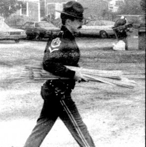 In this Chronicle file photo, a Vermont state trooper carries a bundle of wooden rods out of a restaurant owned by the Island Pond community on June 22, 1984.
