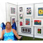Lynn Berard of Barton sold her watercolors at the Crafts of the Lake Region craft show July 28 to benefit the Barton Public Library.  Photo by Tena Starr