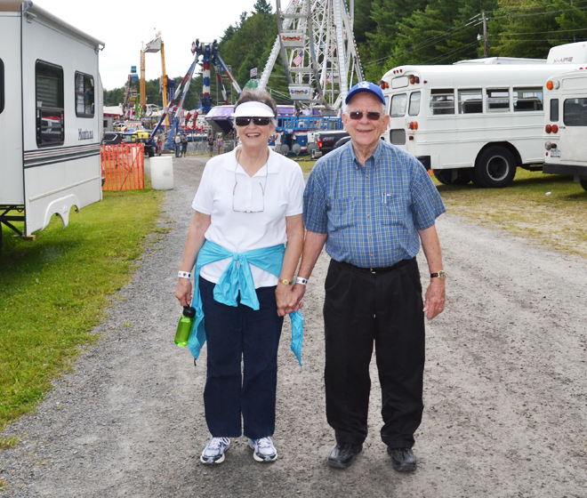 Karin and Dan Maxwell were enjoying the Orleans County Fair and each other's company on Friday, August 16.  They are from North Carolina and have been married 32 years.  Fair attendance was 18,000 over four days, matching last year's record.                                                                                       Photo by Bethany M. Dunbar