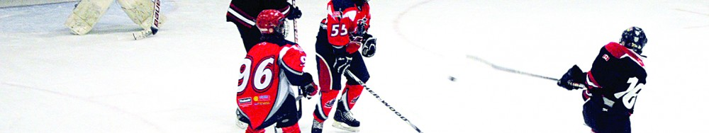 Border Jets player Alex Giroux (right) rips a shot during Border Minor Hockey Association Bantam A action against visiting Clud Piscine SO of Sherbrooke.  Waiting to block the shot are Sherbrooke players Samuel Paquette (foreground) Olivier Fortin (background), fellow Border Jet Brian Smith and Sherbrooke goalie Samuel Nadeau.  Photo by Richard Creaser