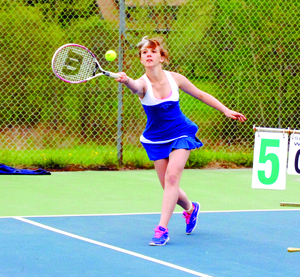 Ranger Olivia McKenna reaches and returns the ball in girls varsity doubles tennis play at Lake Region on Monday.  Photo by Richard Creaser