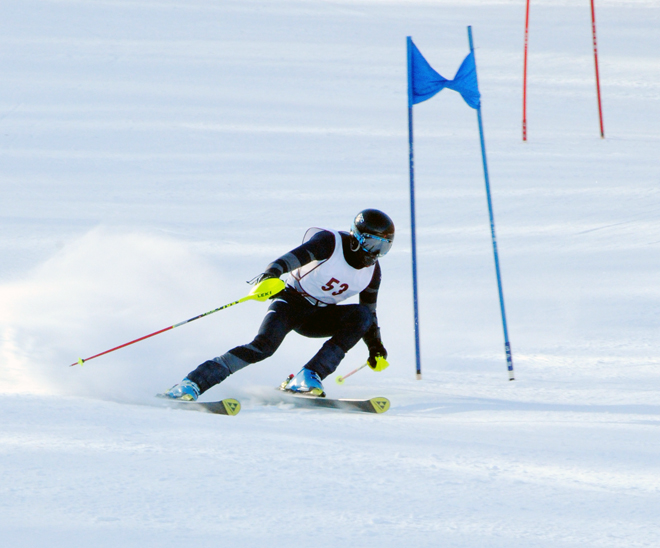 North Country Falcon Justin Berthiaume tucks into a tight corner on the slalom course at Jay Peak on Friday.  Photo by Richard Creaser
