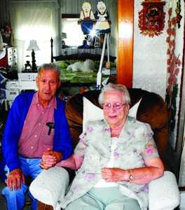 Jim and Shirley Hemenway in the living room of the house where Mr. Hemenway was born and where they have spent 72 of their 75 years together.  Mr. Hemenway is 96, Mrs. Hemenway is 92.  The house is filled with Mr. Hemenway's woodworking and Mrs. Hemenway's quilts, along with her collection of blue willow, family photos and many other mementos of a long life. Photo by Elizabeth Trail