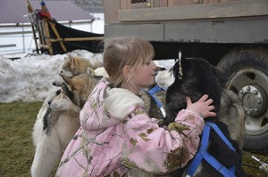 Nine-year-old Nevaeh Maskell indulges Koda's need for attention with a kiss.