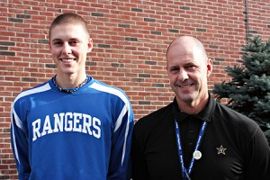 LRUHS pitcher Matt Messier, and his father, Principal Andre Messier, pause for this photo Thursday afternoon.  Photo by David Dudley