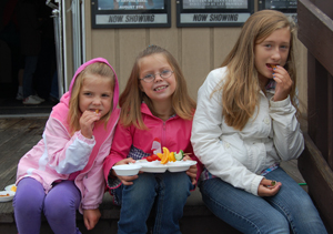 From left to right, Zylus and her sister Giada Hodges of Newport, and Autumn Walsh of Brownington enjoy healthy snacks provided by Meghan Stotko and the Lunch Box at Saturday's screening of Weight of the Nation, sponsored by the district health department.   Photo by Tena Starr