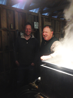 Darrell Bussino (left) and Bucky Shelton have started a new kind of sugaring venture.  They're making birch syrup, which had a retail price last year of $78 a quart.  Photo by Jeremy Dean