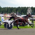 Mighty Me driven by Andy Gardner clocks in at 1:59:03 in the Eleanor Churchill Memorial Pace.  It was only the third time in the 145-year history of the fair that a horse finished the mile in less than two minutes. Photo by Joseph Gresser