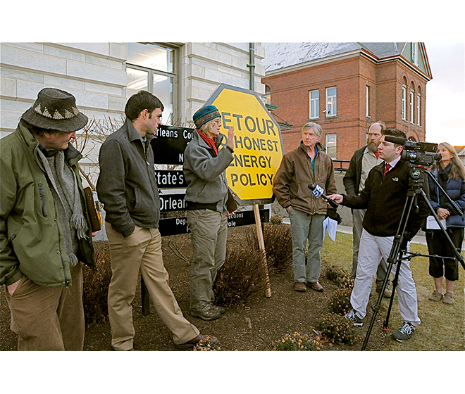 Lowell Six wind protesters are interviewed by David Charns of WPTZ News Channel 5.  Photo by Steve Wright