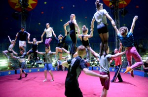 Cuban coach Emilio D. Sobrino Sensiales instructs 13 Circus Smirkus troupers as they form a giant, spinning pyramid.